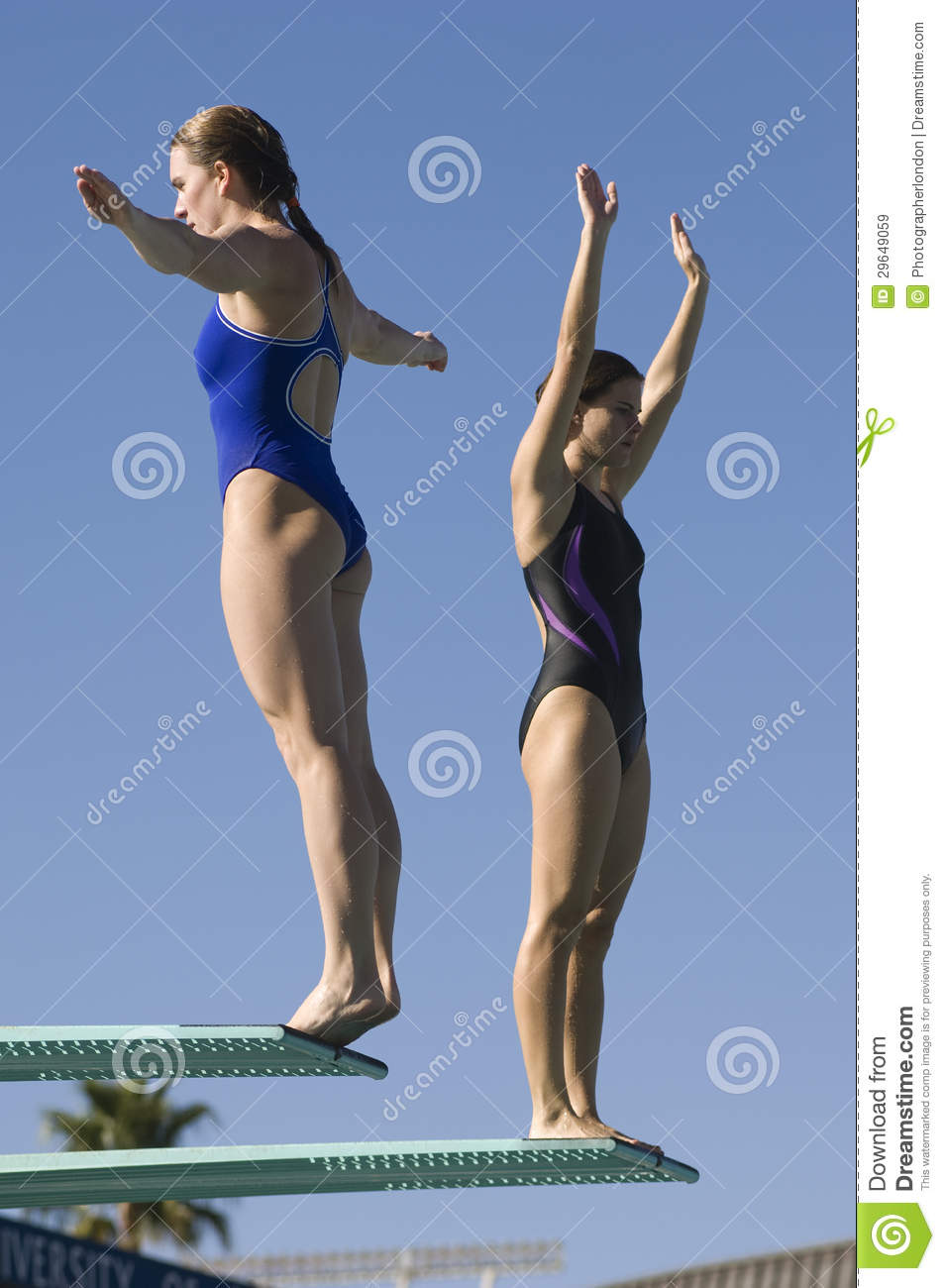 Female Swimmers On Diving Board