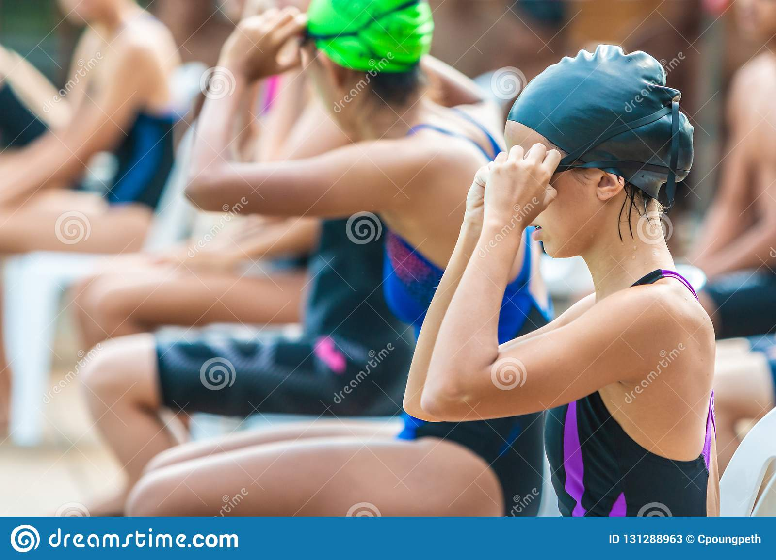 Female swimmers getting ready and waiting to swim