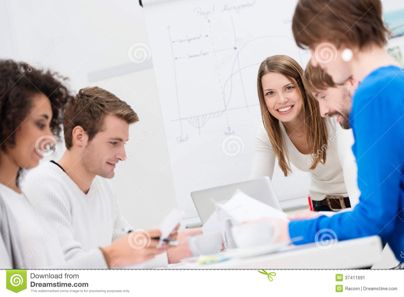 Female team leader with her business team