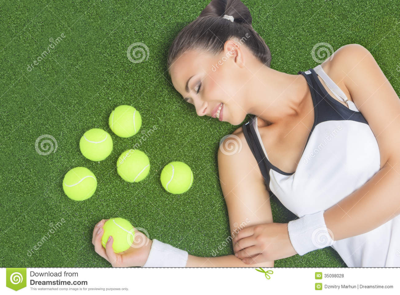 Female Tennis Player Lying On Artificial Grass Surface ...