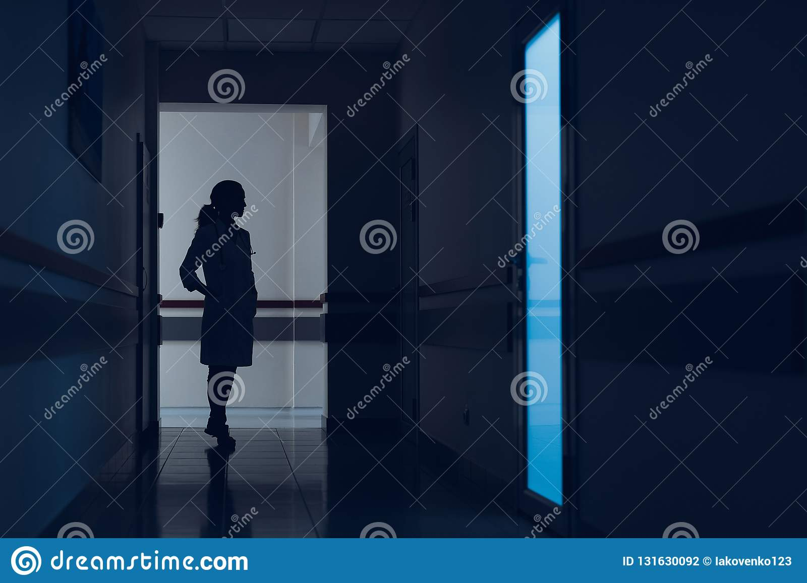 Female therapist is standing in hallway in the hospital