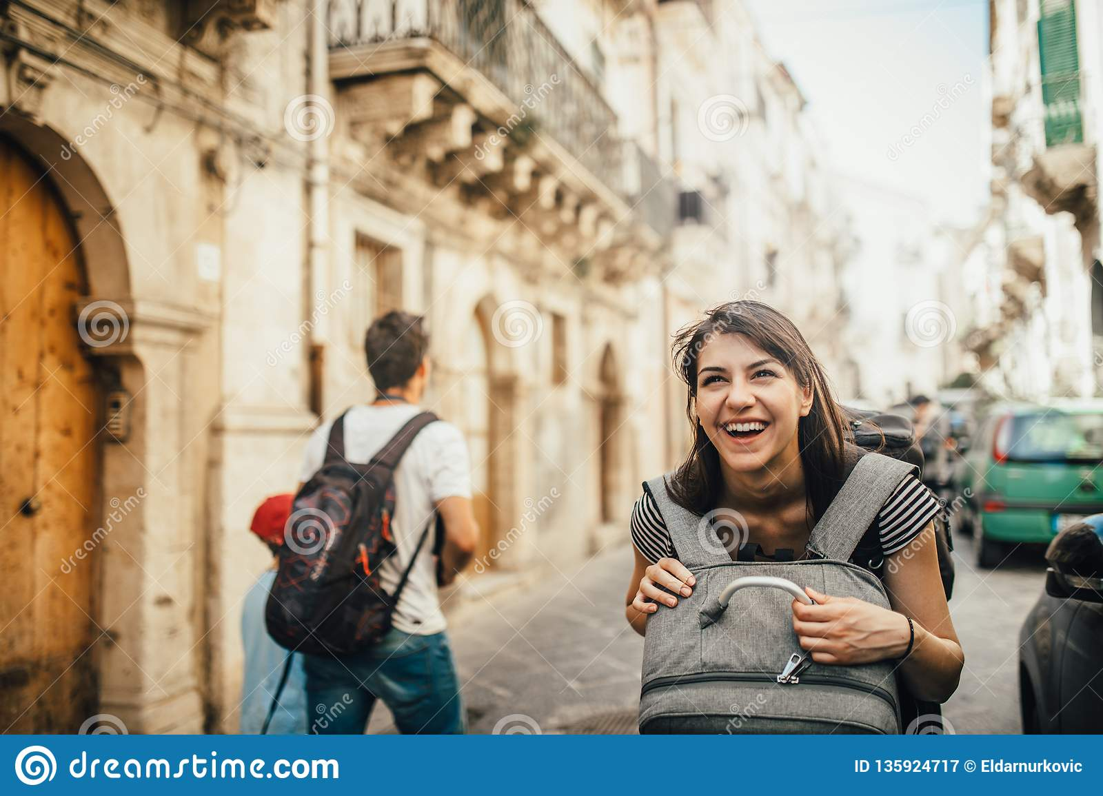 Female tourist backpacker visiting Italy.Woman in Syracuse,Sicily.Old town of Syracuse, Ortigia island visitor.Travel destination