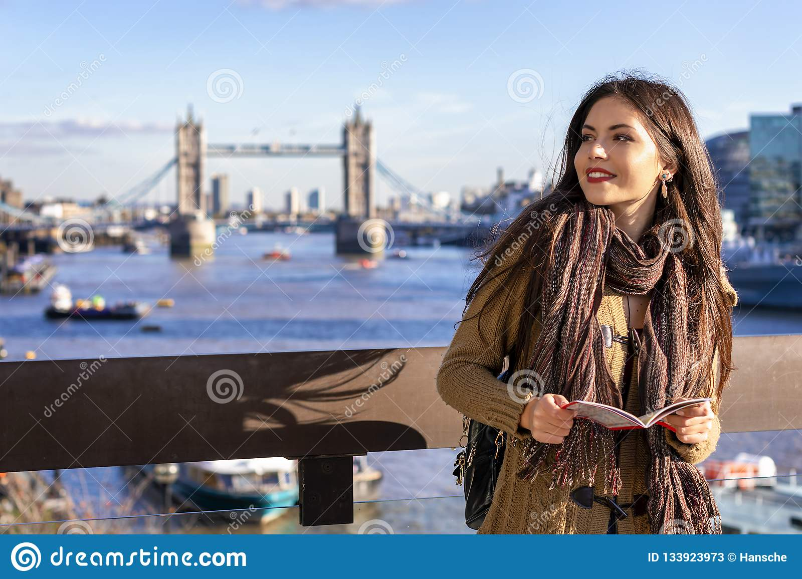Female tourist in London holding a city map