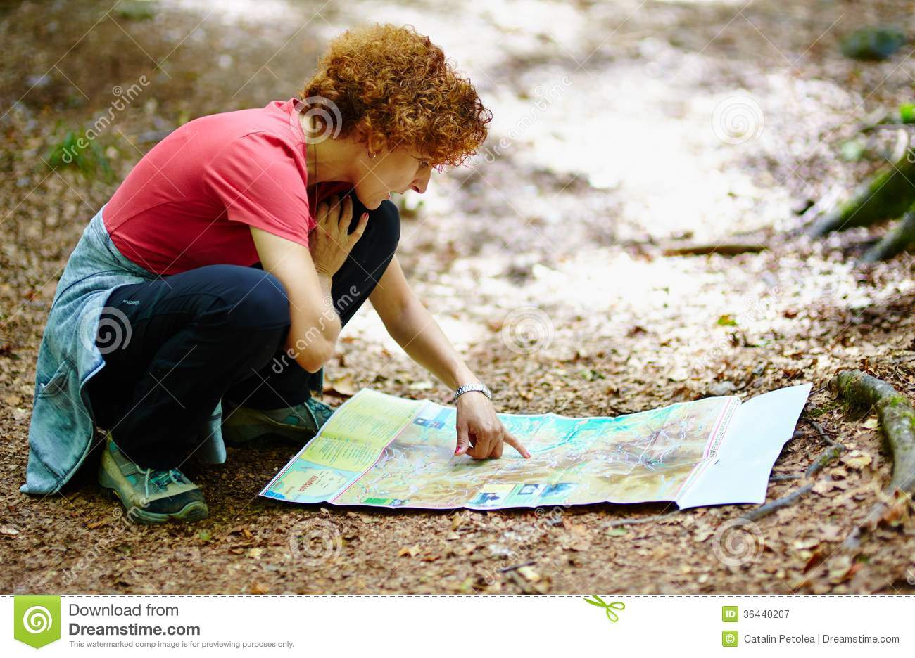Female tourist looking on a map