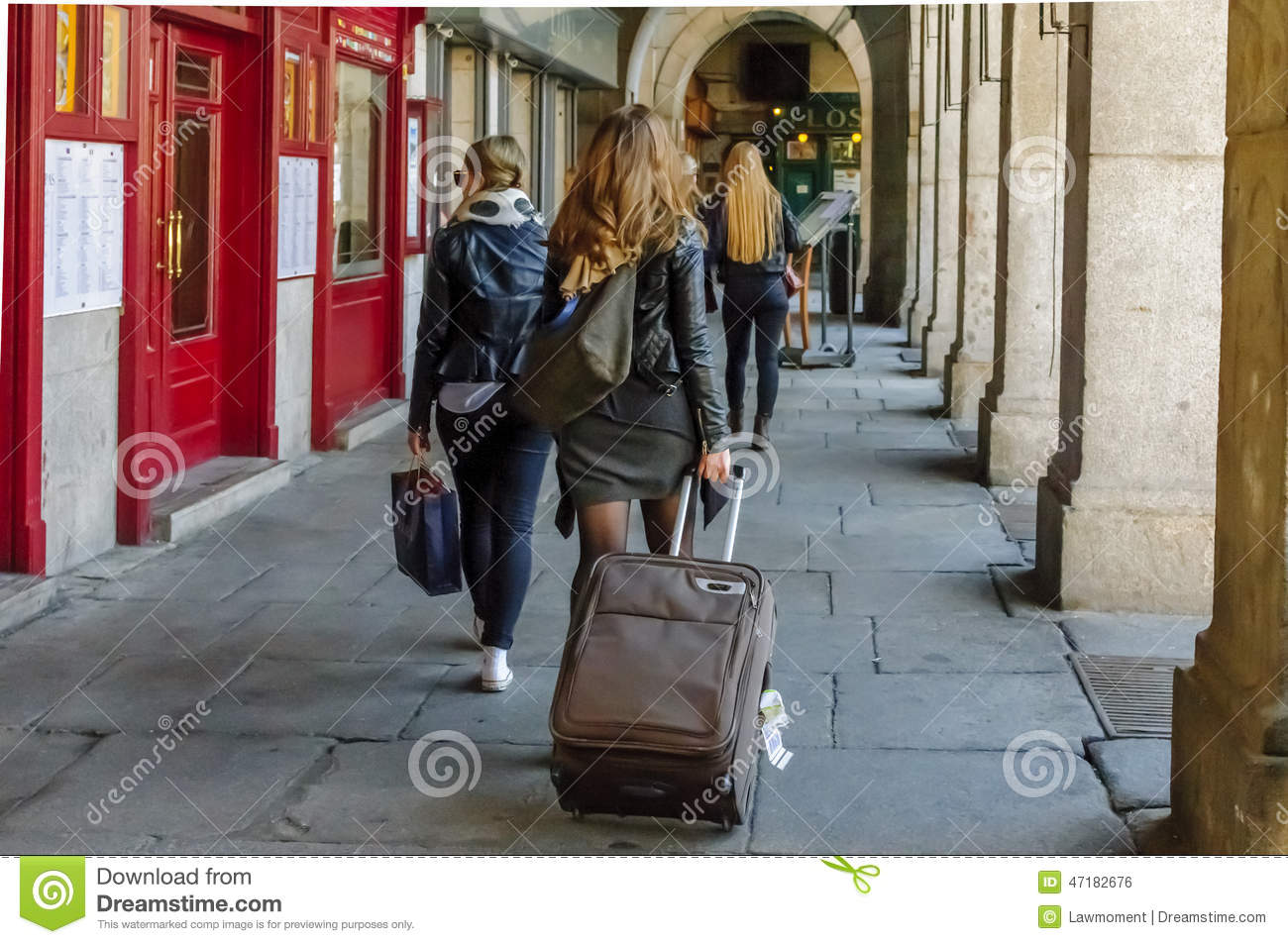 Female Tourist Pulling Travel Bag In Plaza Mayor Editorial Photo ...
