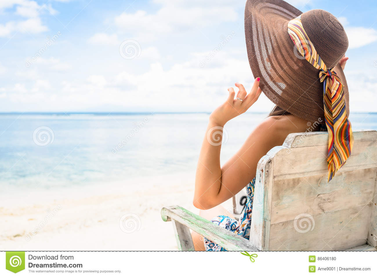Female Tourist Relaxing In Deck Chair At Beach In Vacation ...
