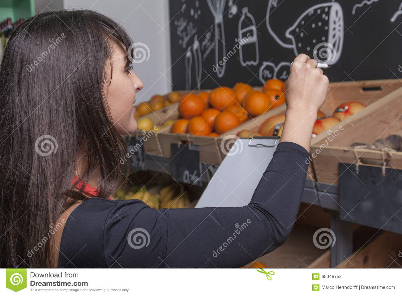 Female trainee counts fruits while the inventory
