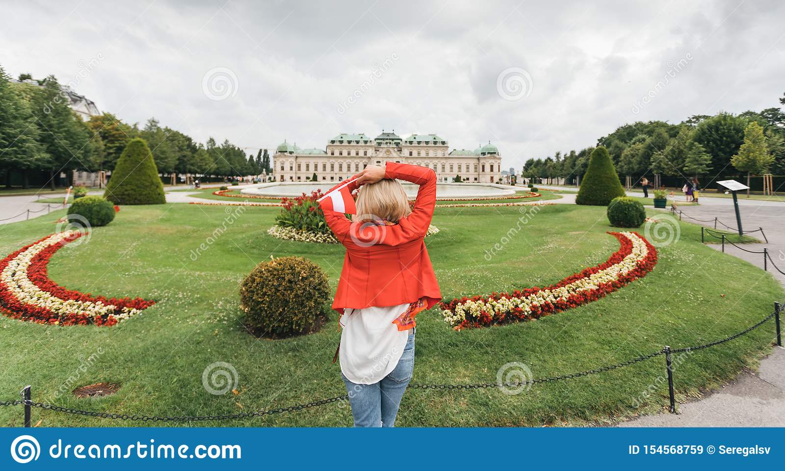 Female traveler on the background of Belvedere Palace complex of the 18th century in Vienna, Austria.