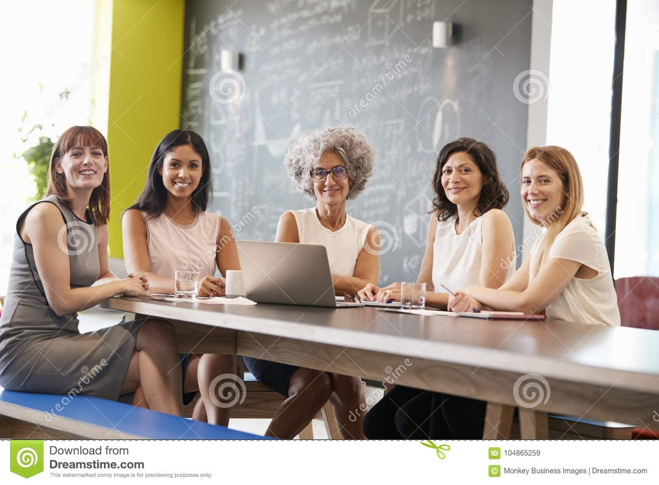 Female work colleagues at informal meeting looking to camera