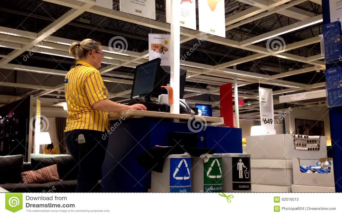 female worker at information station checking some data stock video video of ikea shop 62016513