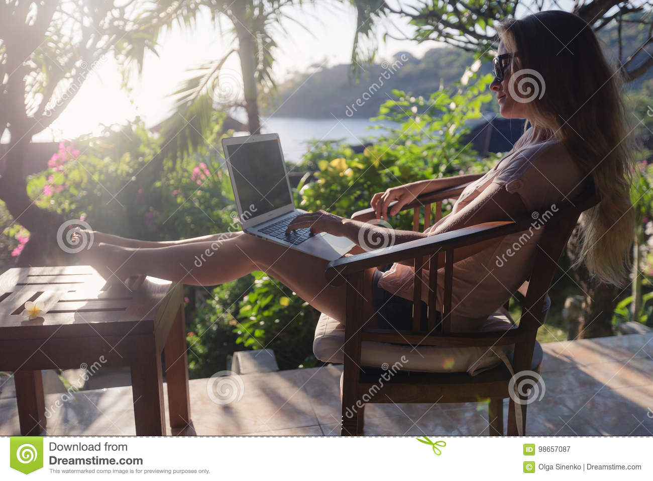 Female working with her laptop outdoors