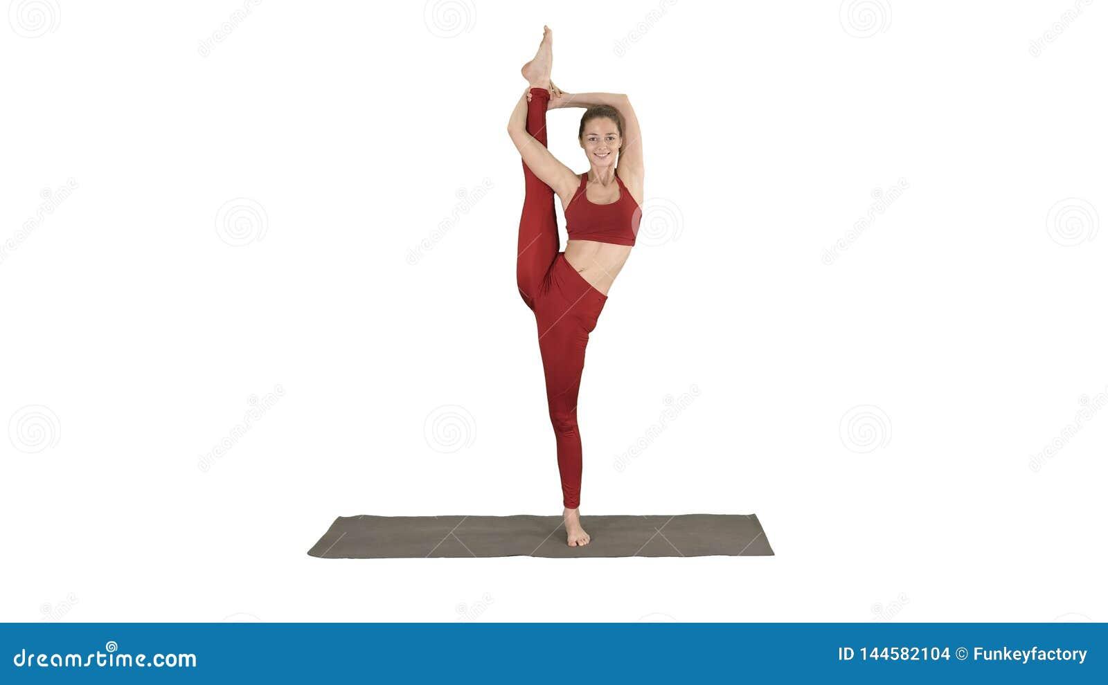 Female Yoga Model Making Standing Split Smiling on white background.