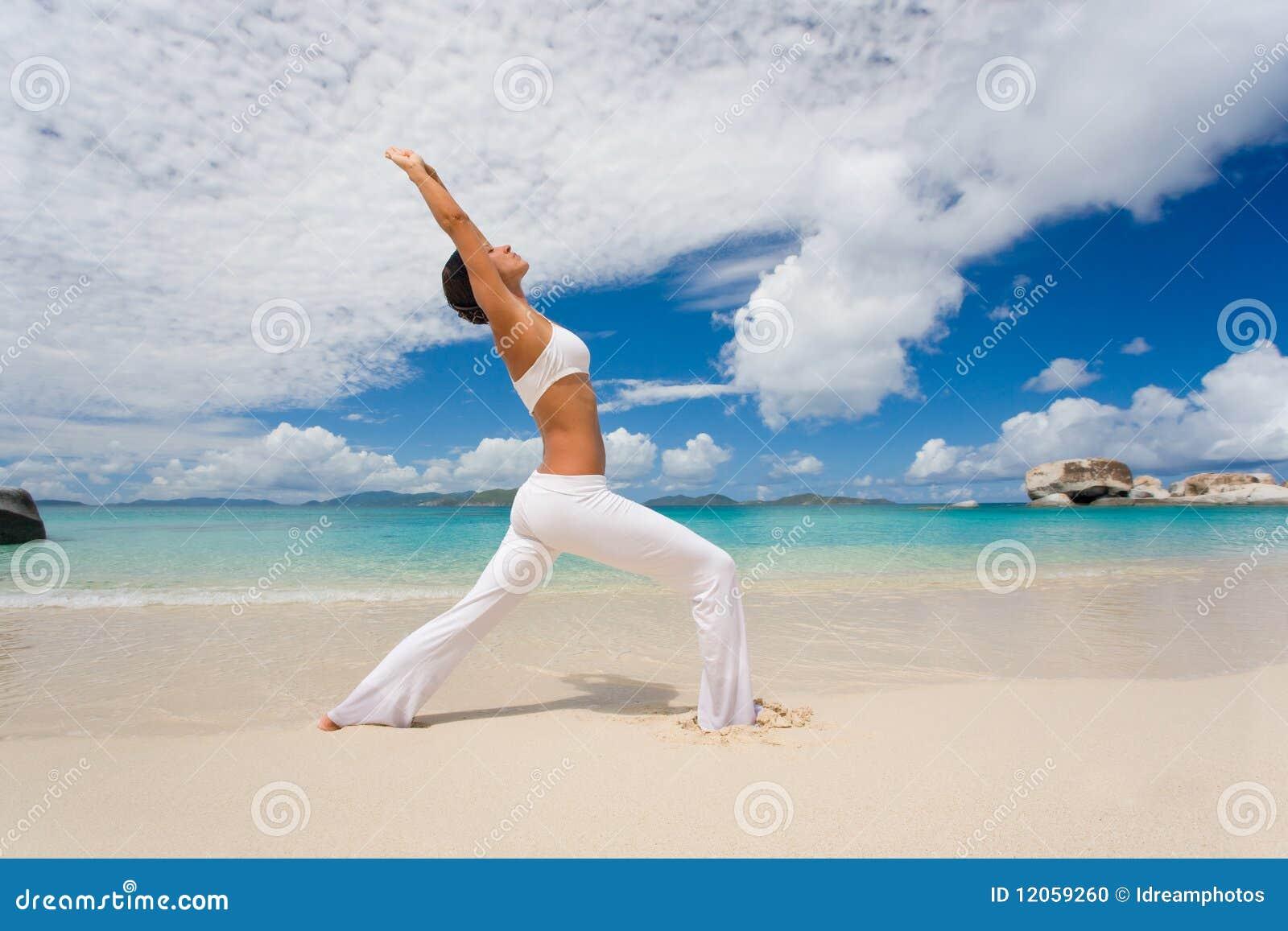 Female yoga stretch beach
