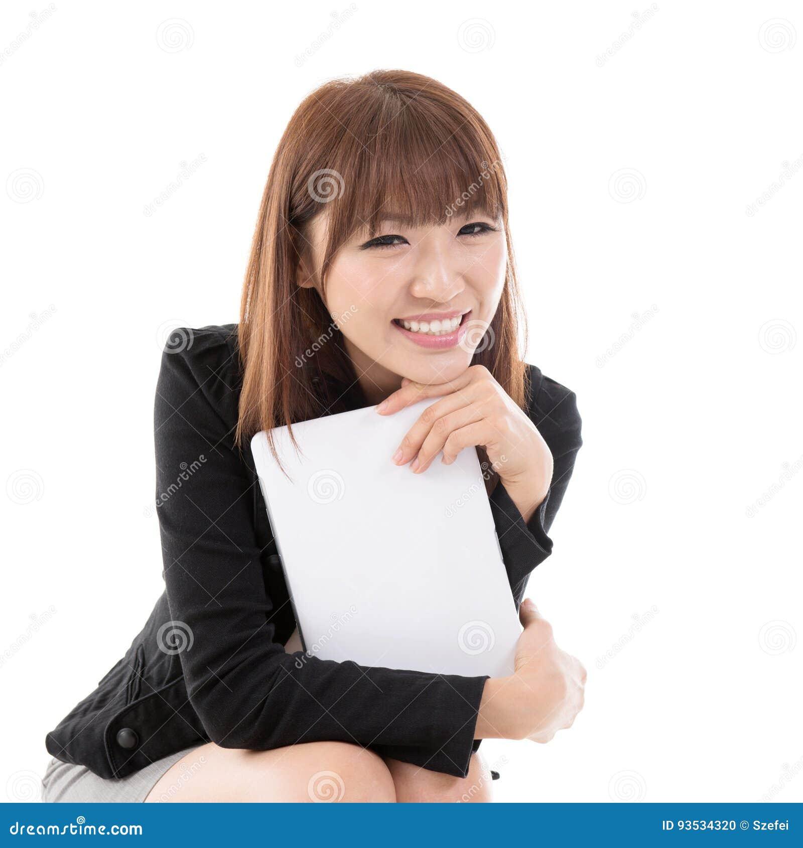 Femelle avec le comprimé d ordinateur