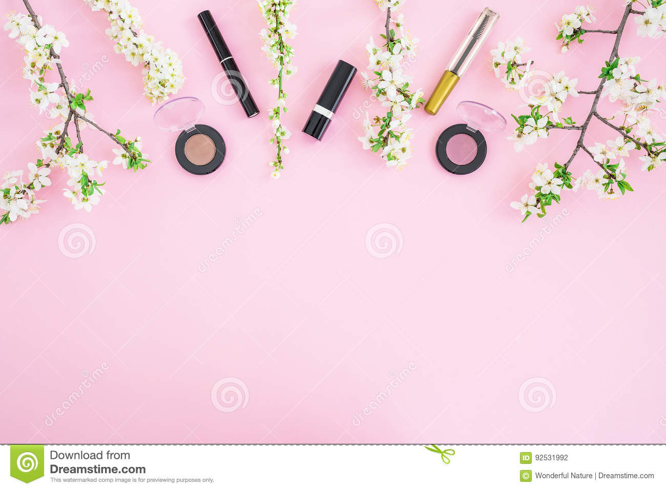Feminine desk with cosmetic: lipstick, shadows, mascara and white spring flowers on pink background. Flat lay, top view. Beauty co
