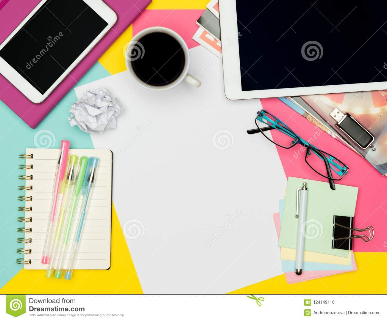 Feminine Office Desk Working Space Flat Lay. Top view photo of workspace with blank sheet of paper mock up and fashion magazines.