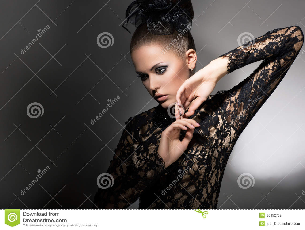 Femininity. Attractive Stylized Woman in Black Dress with Bow-knot. Neatness