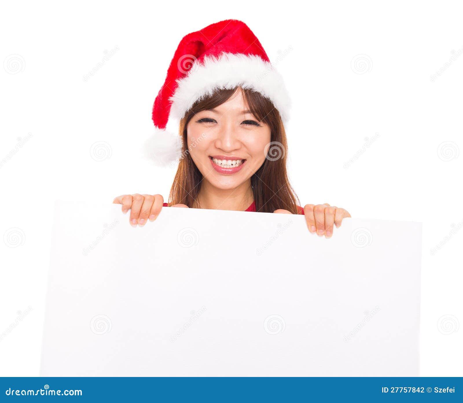 Femme asiatique de Noël au-dessus de signe de panneau-réclame