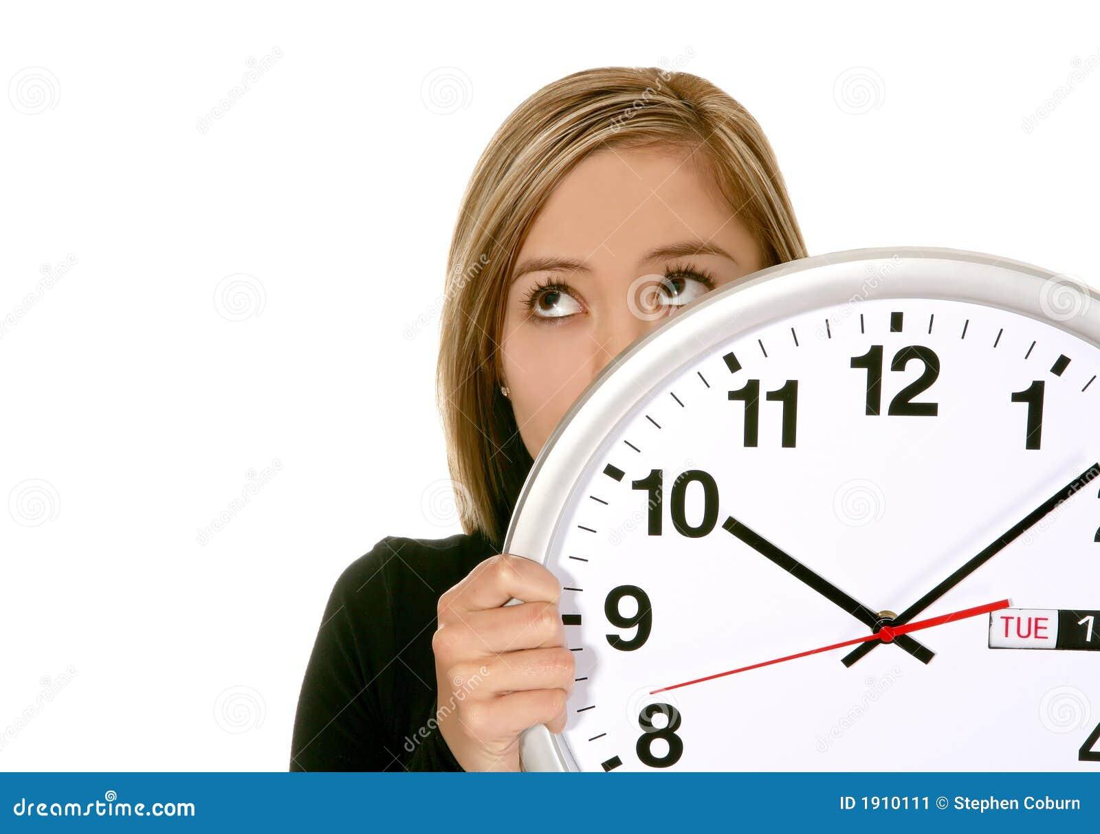Femme d affaires avec l horloge