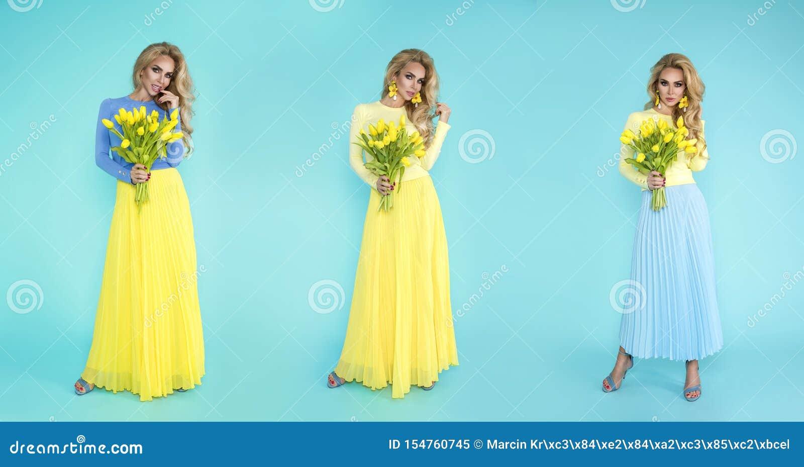 Femme de source Fille de mod?le d ?t? de beaut? avec les v?tements color?s, tenant un bouquet des fleurs de ressort Belle dame av
