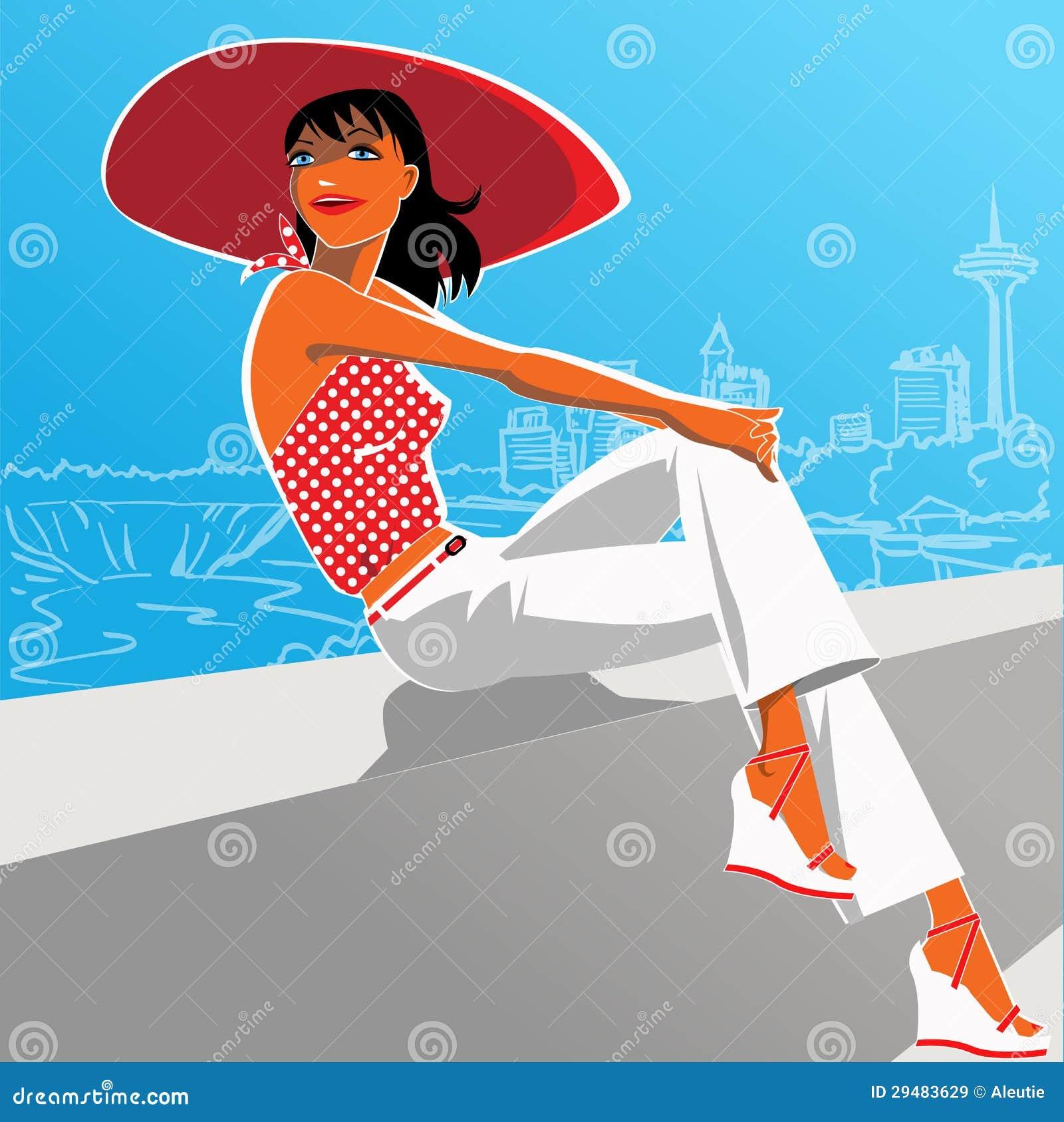 Femme sexy dans l équipement des années 1950 et un chapeau rouge