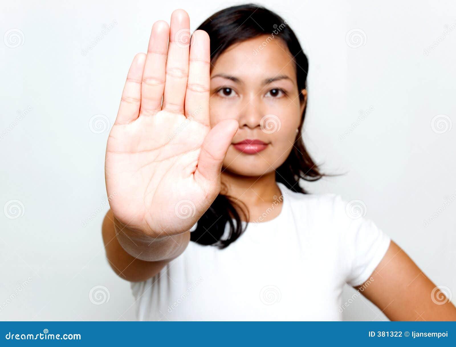 Femmes avec le signe d arrêt