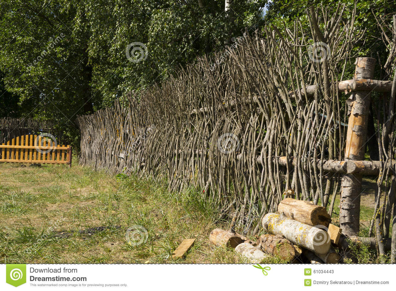 A fence made of tree branches stock image