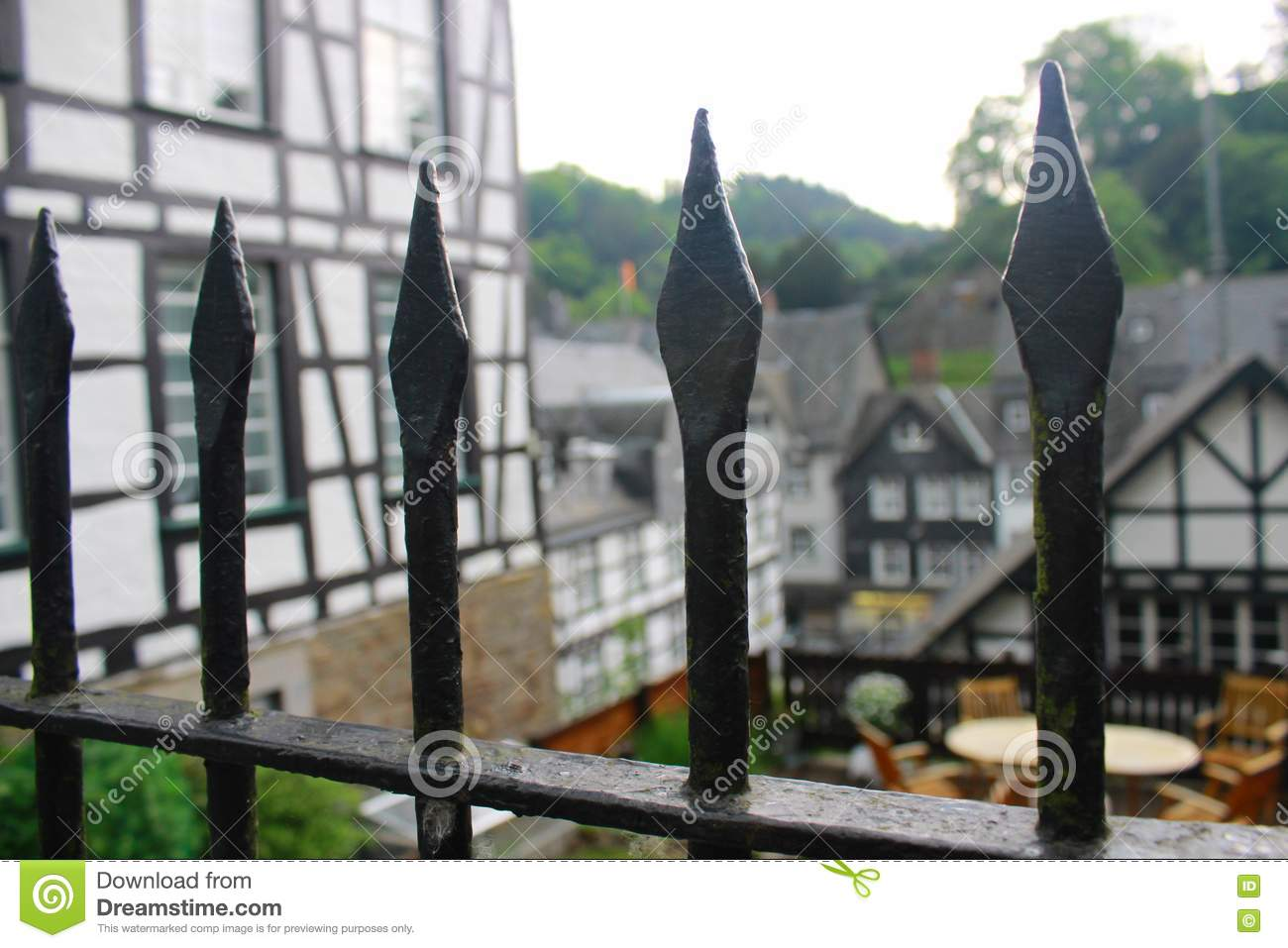 Fence peaks and historic tudor style buildings in monschau Tudor style fence