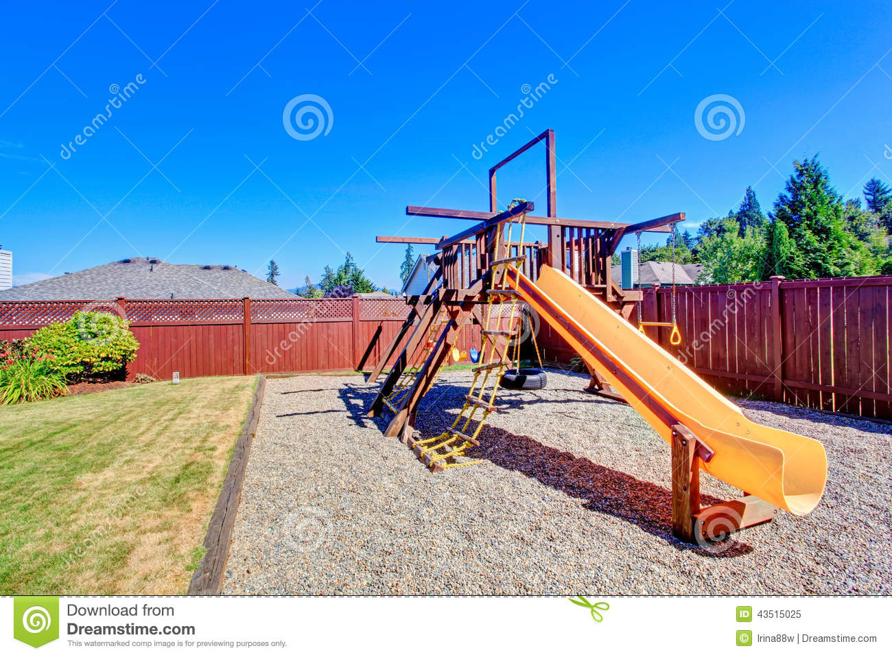 Fenced backyard with playground for kids stock image for Kids home playground