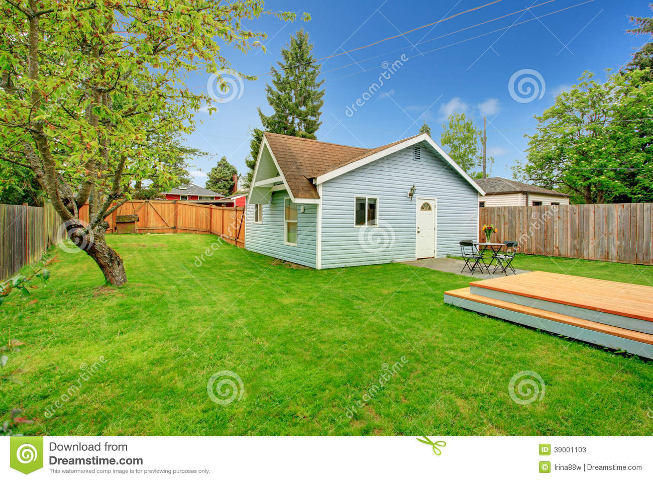 Fenced Backyard With Small Patio Area Stock Photo - Image