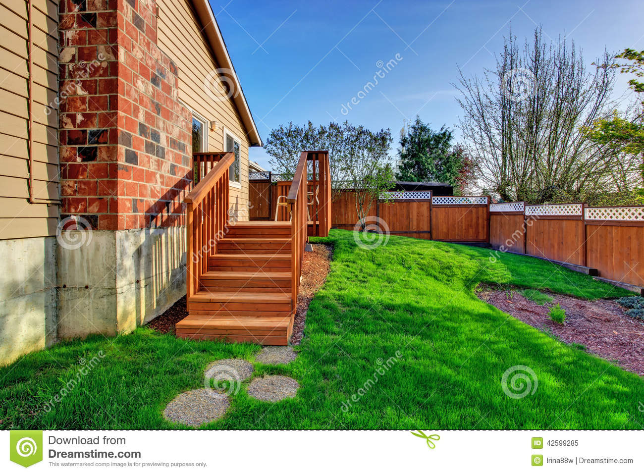 fenced backyard with walkout deck stock photo image