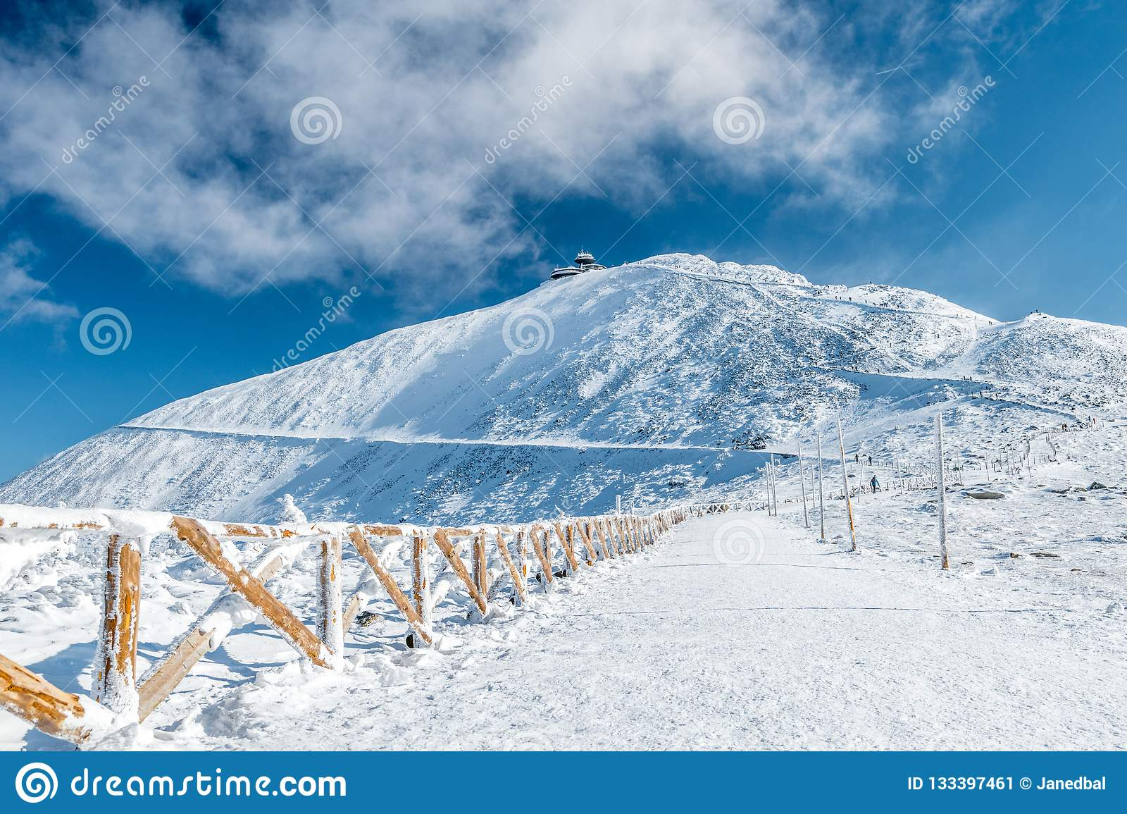 Fenced hiking path to Snezka mountain on a sunny day in winter, Giant mountains Krkonose, Czech republic