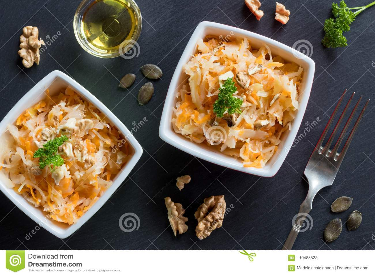 Fermented cabbage and carrots in two bowls