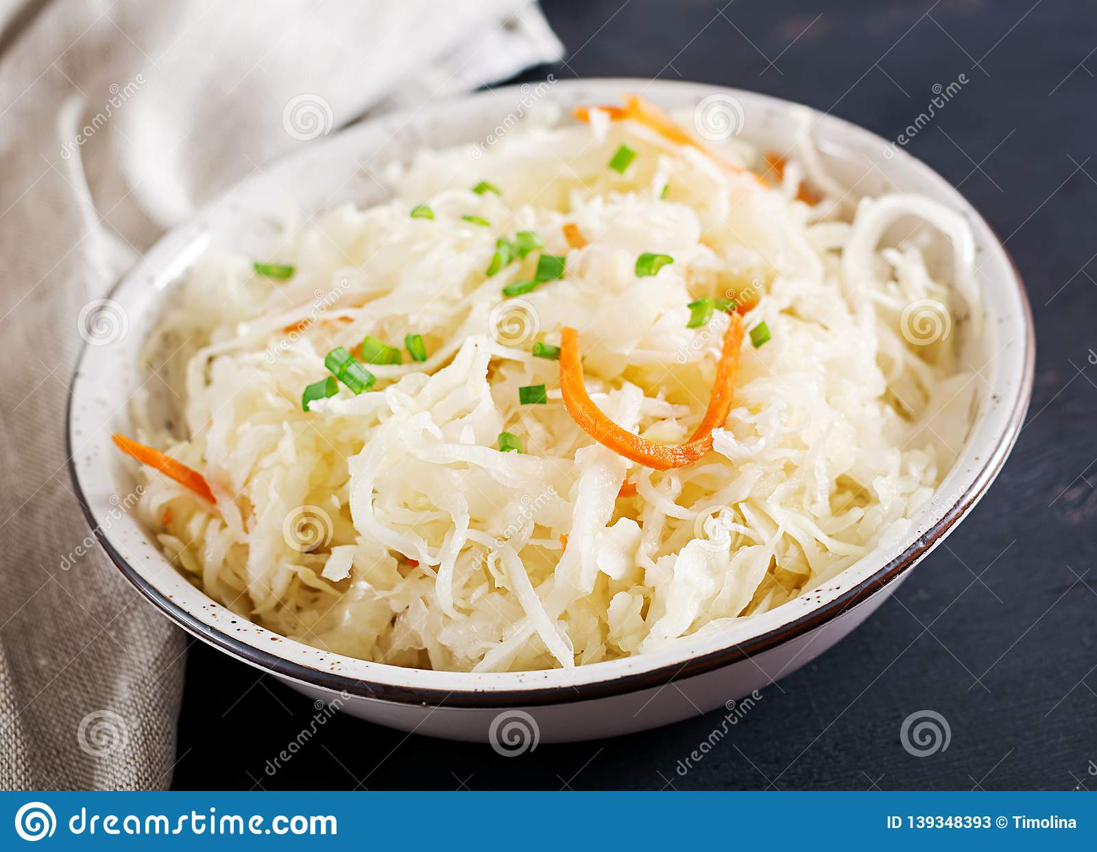 Fermented cabbage. Vegan food. Sauerkraut with carrot and spices