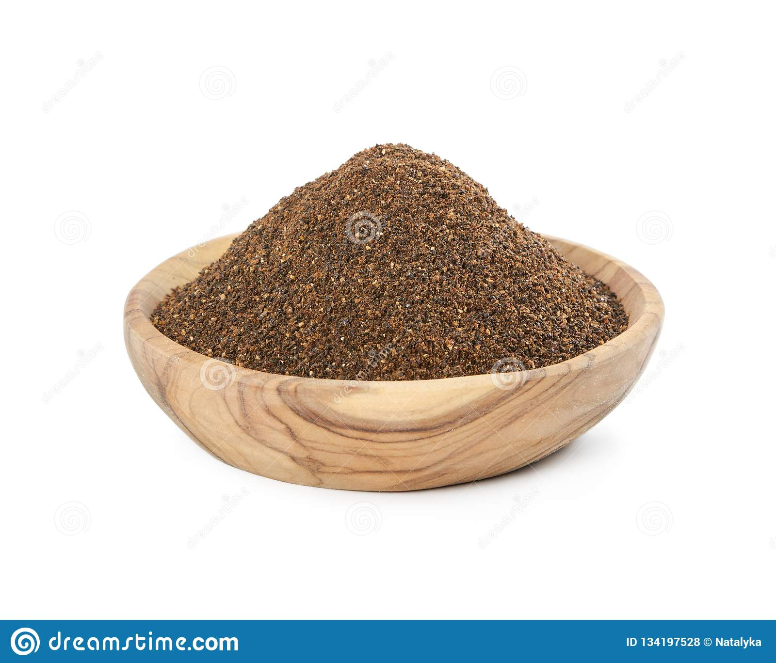 Fermented rye malt in wooden bowl isolated on white