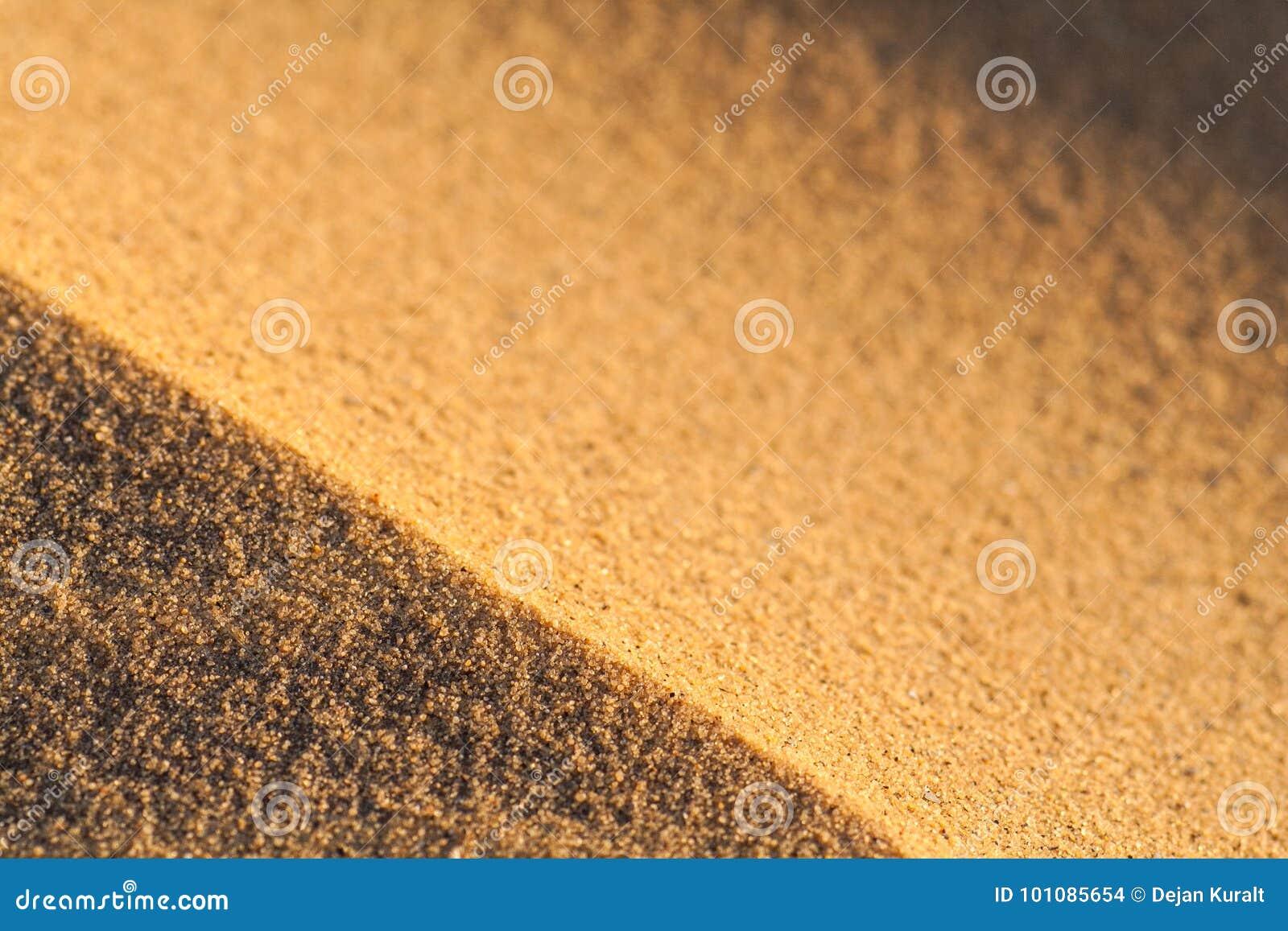 Fermez-vous vers le haut de la macro texture de la dune de sable