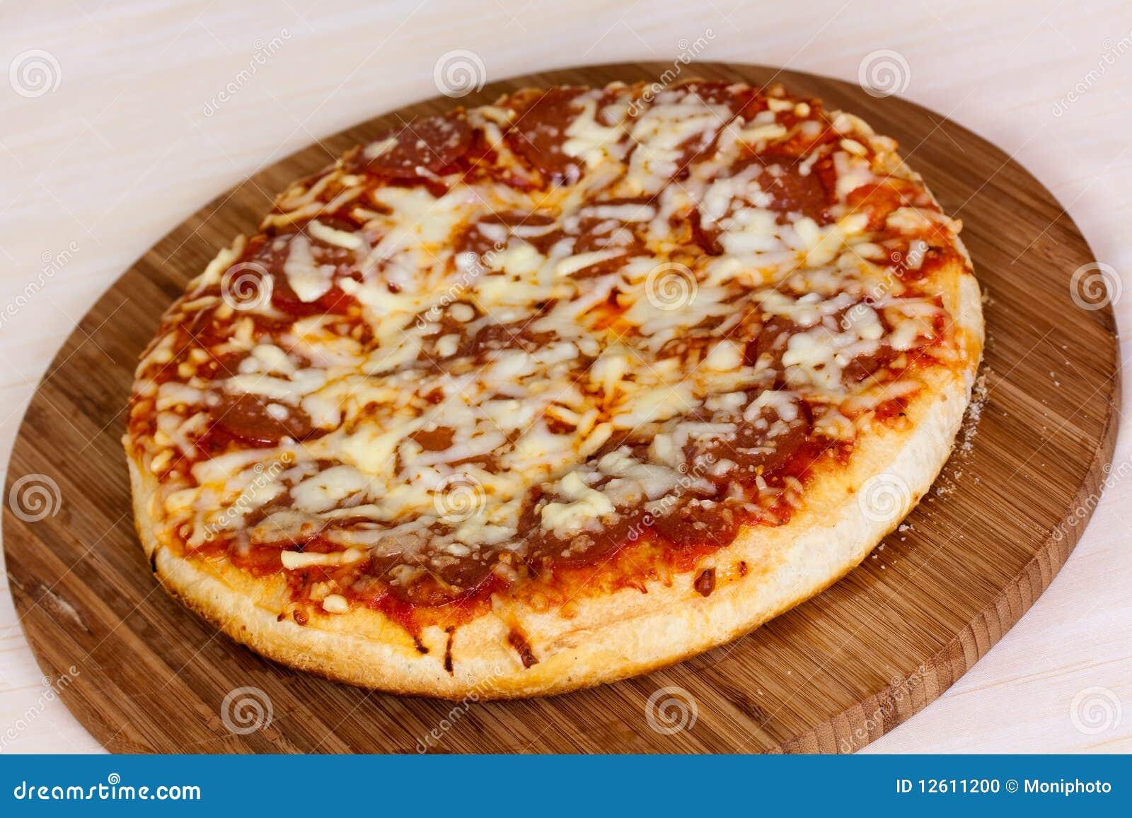 Fermez vous vers le haut de la pizza avec des tomates for Vers dans les tomates