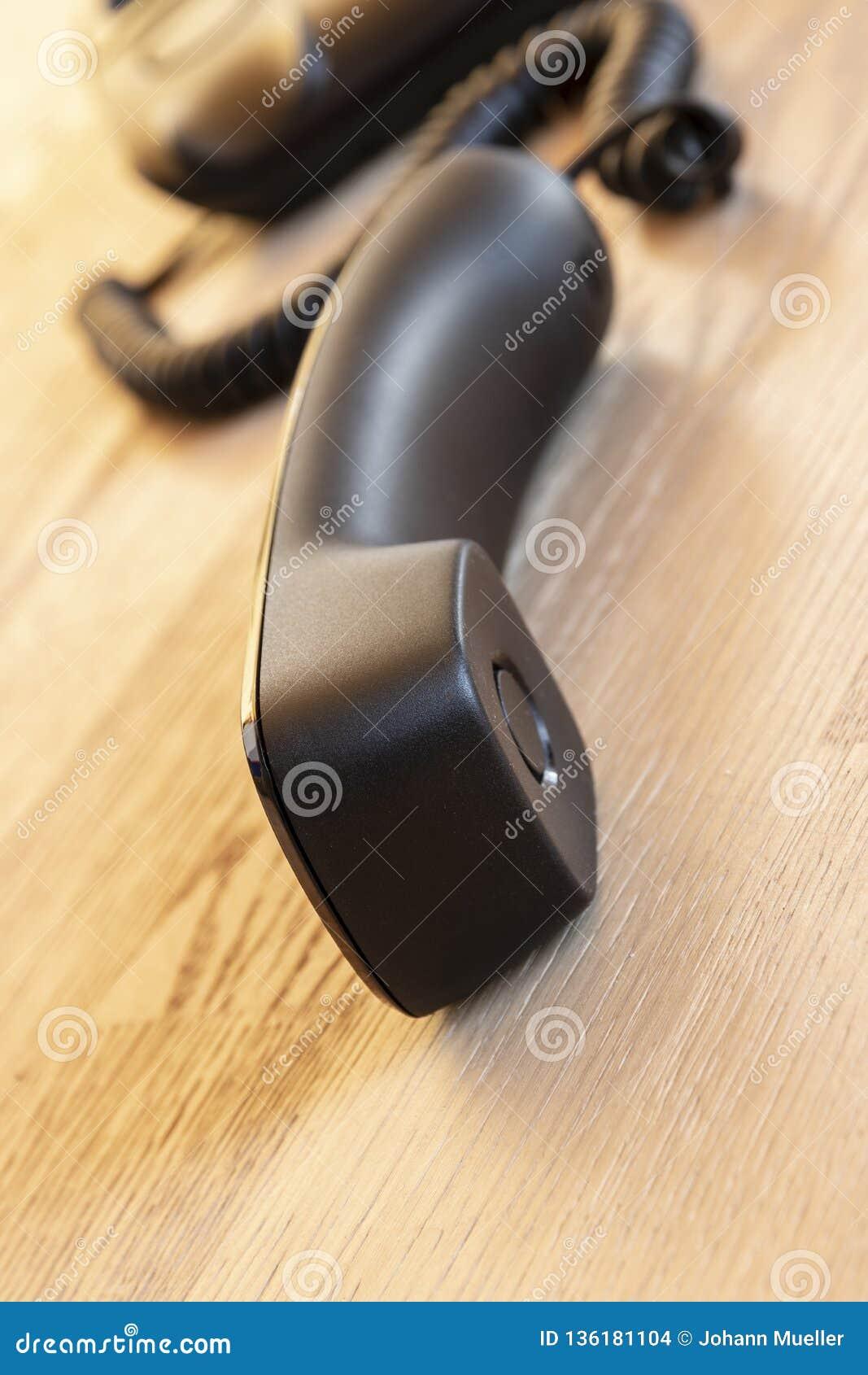 Fermez-vous vers le haut du foyer mou sur des dispositifs de téléphone au bureau