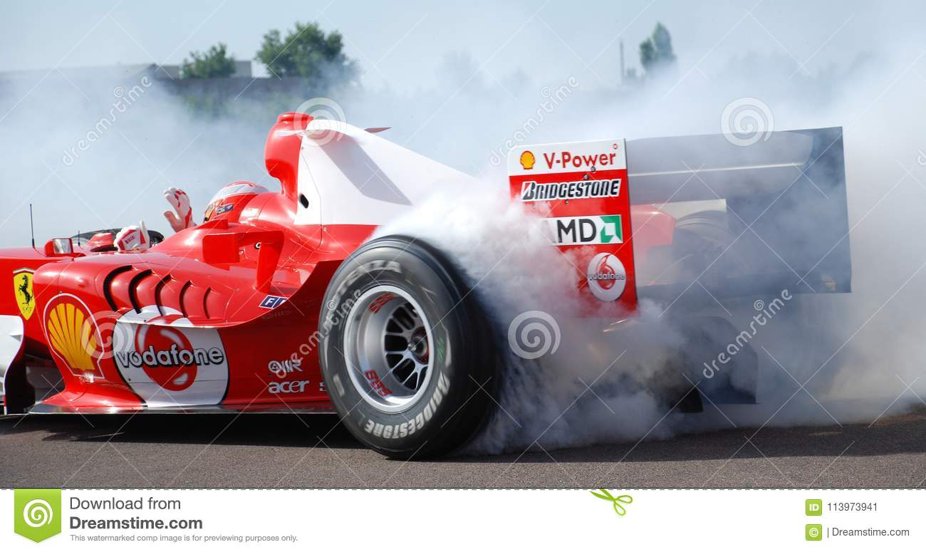 Ferrari F1 Michael Schumacher Donut Smoking Tyre At Fiorano Circuit Italy One Handed Driving With Wave During Donut Editorial Photo Image Of Wave 60th 113973941