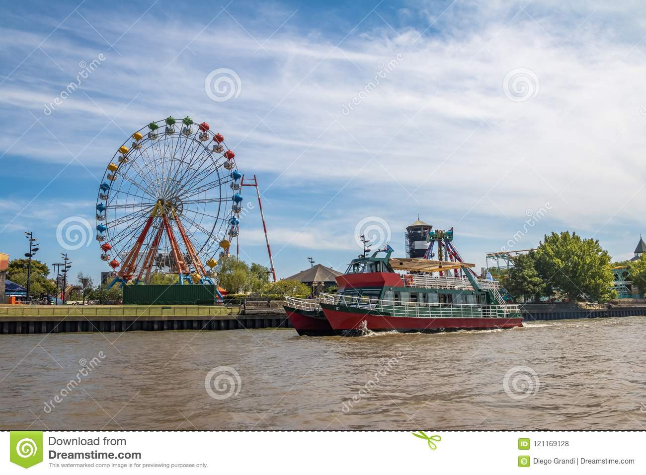 Ferris Wheel, amusement park and ferry boat in Lujan River - Tigre, Buenos Aires, Argentina