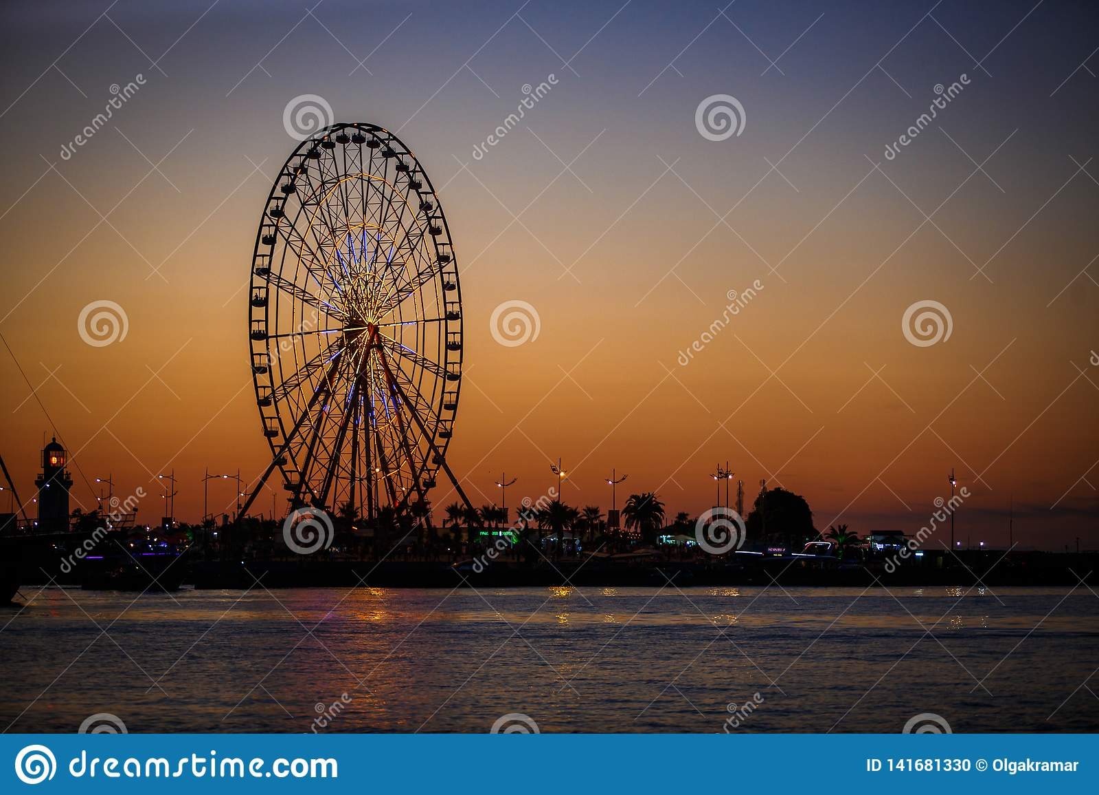 Ferris Wheel And Georgian Alphabet Tower On Orange Sunset Background Editorial Image Image Of Embankment Blue 141681330