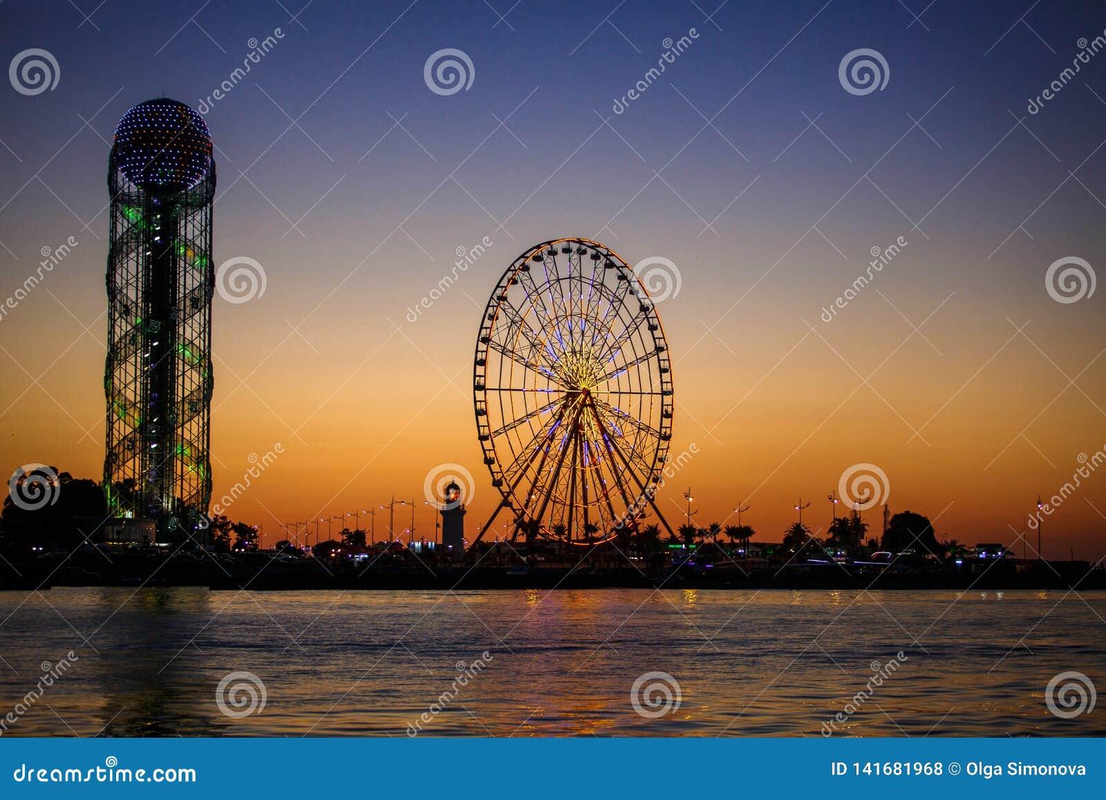 Ferris Wheel And Georgian Alphabet Tower On Orange Sunset Background Editorial Stock Photo Image Of High Circle 141681968