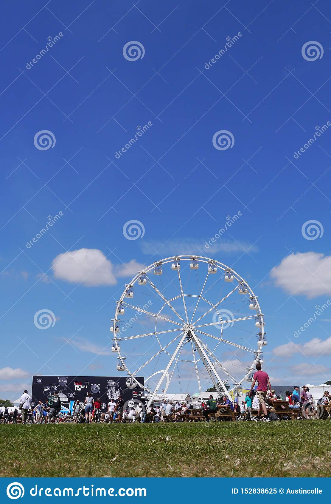 Ferris wheel and graduated blue sky at Goodwood Festival of Speed. UK
