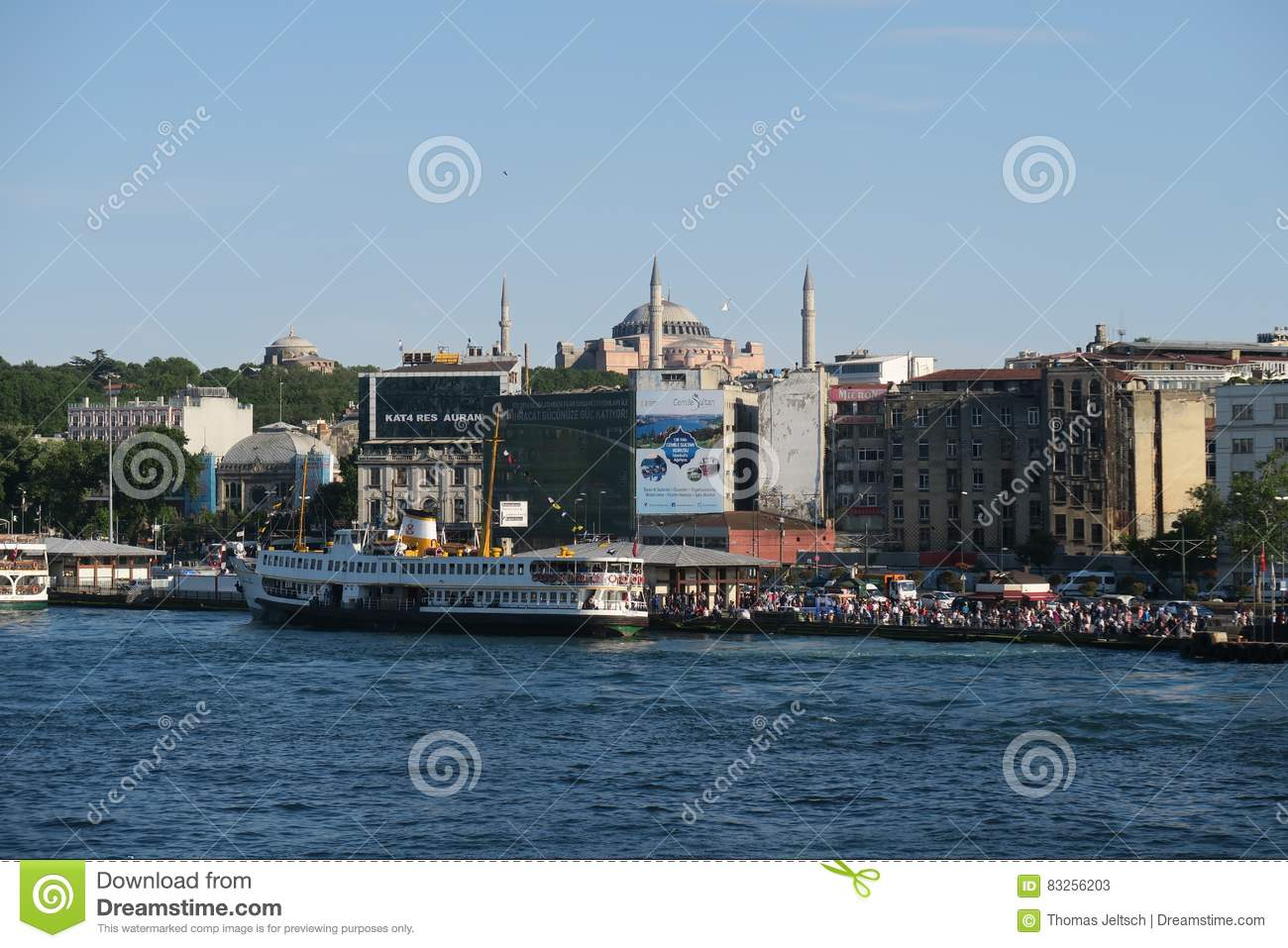 Ferry near Galata Bridge and the Golden Horn, with Hagia Sophia, in Istanbul, Turkey