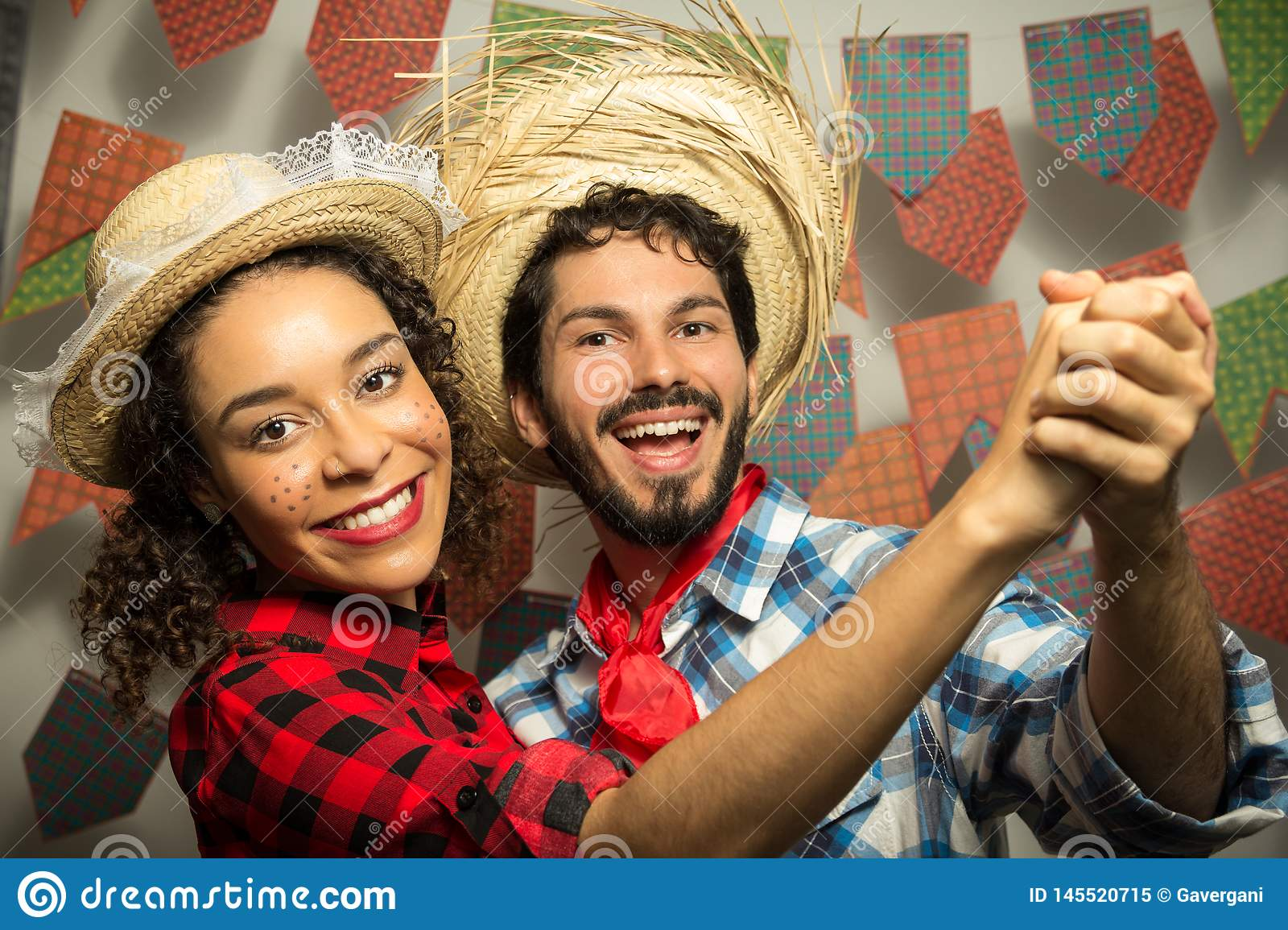 Festa Junina: party in Brazil. Man and woman dressing checked pattern clothes. Man and woman dressing checked pattern clothes are