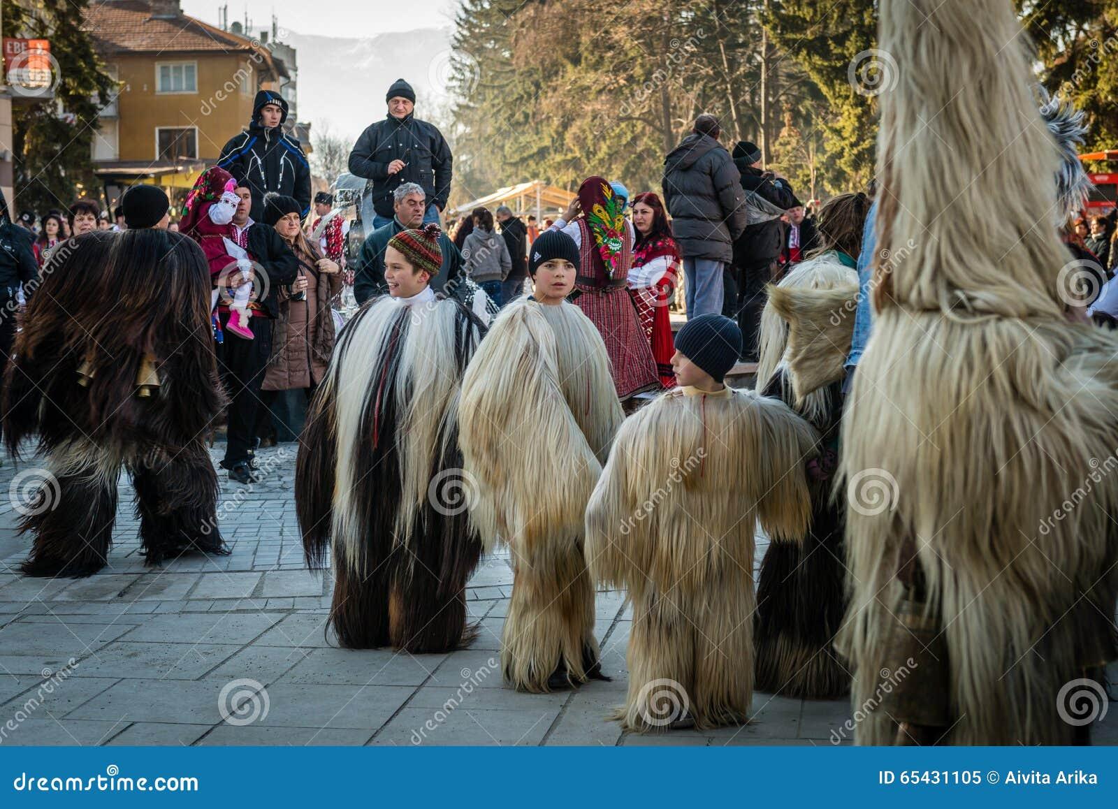 Razlog Bulgaria  city photos : Razlog, Bulgaria January 01, 2016: Children in costumes are taking ...