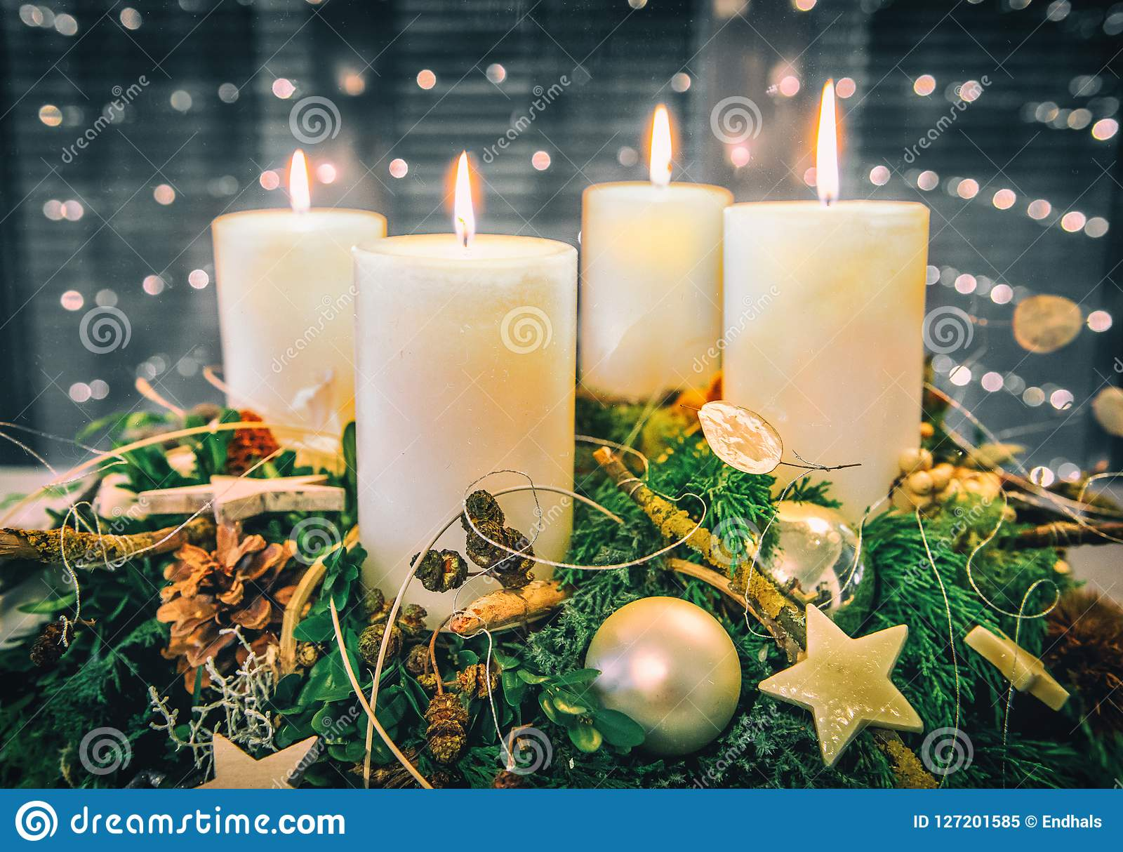 Festive Advent Wreath with burning candles