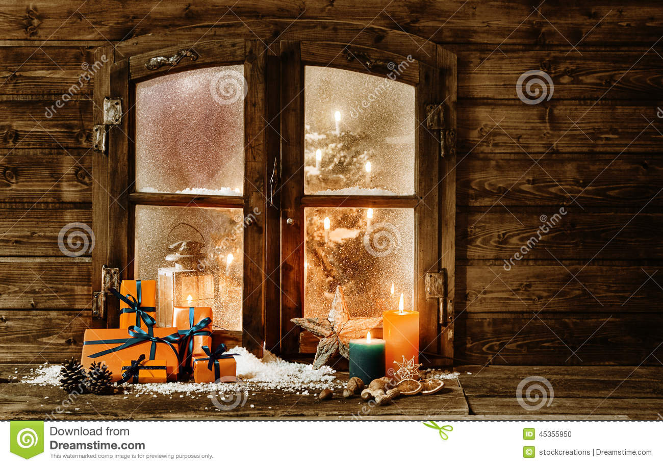 festive christmas cabin window stock photo