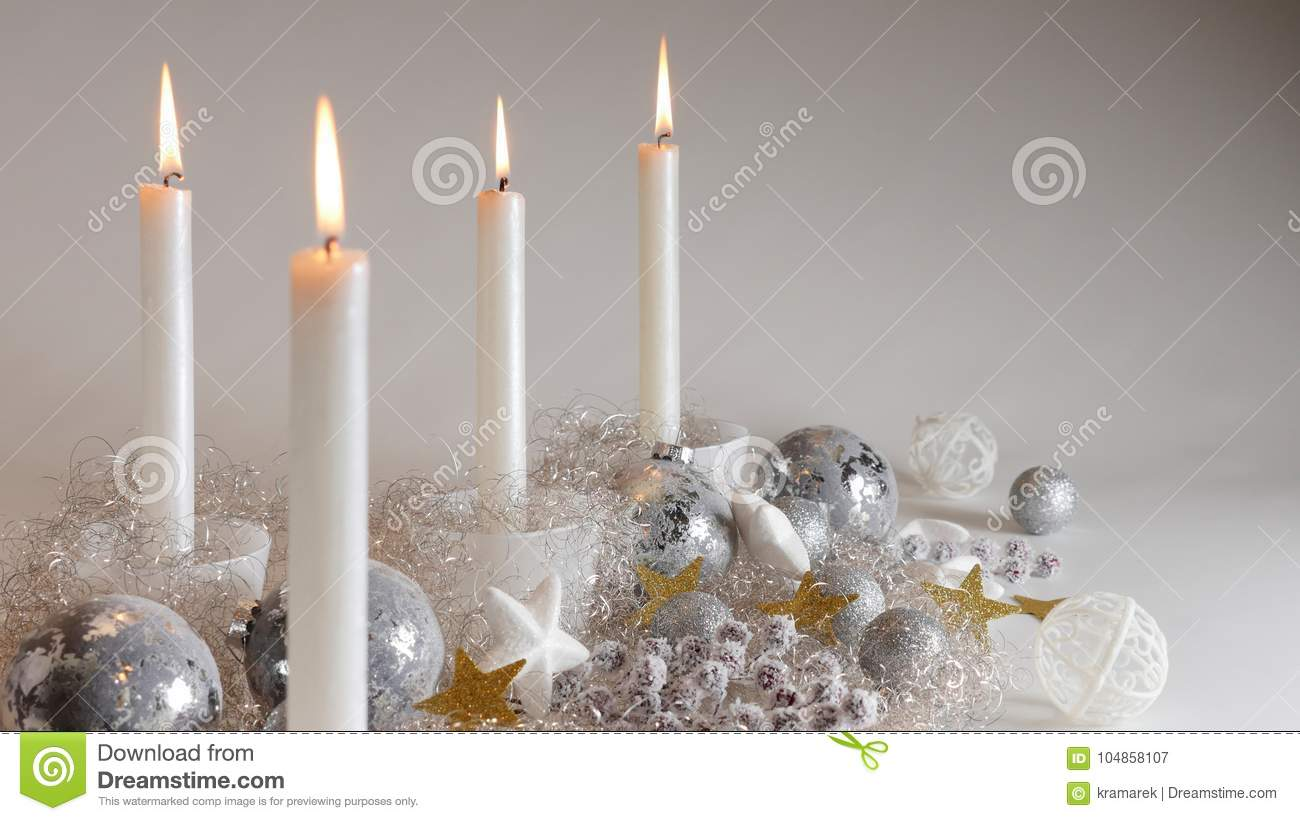 download festive christmas decoration with four candlelights glitter balls and sparcling angel hair stock image