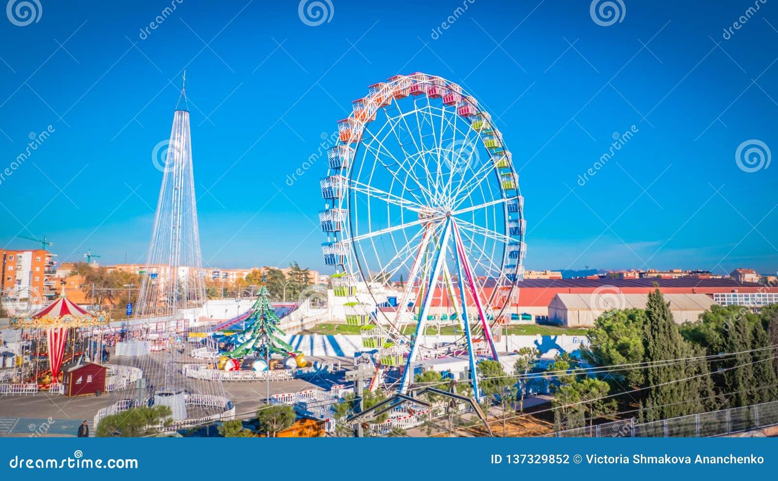 Festive Christmas fair with a Ferris wheel in Torrejon de Ardoz near Madrid, Spain